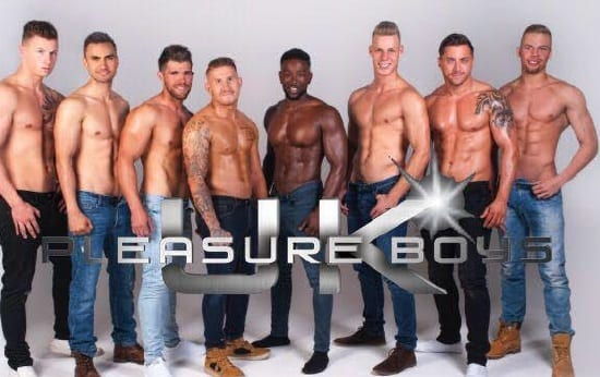 8 men with their tops off posing for the UK pleasure Boys activity for a hen party