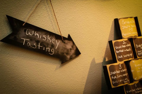 Sign pointing to whiskey tasting plaques