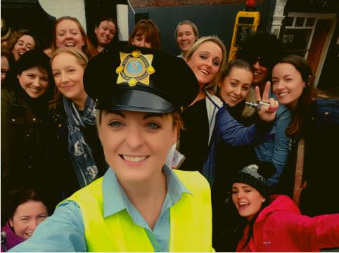 a hen party doing a csi save the groom hen party activity with a garda