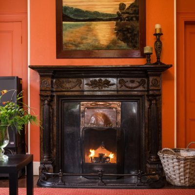 a fireplace in the sitting room of Banba house in galway