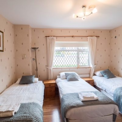 3 Single beds in a bright bedroom Oak House Self catering House