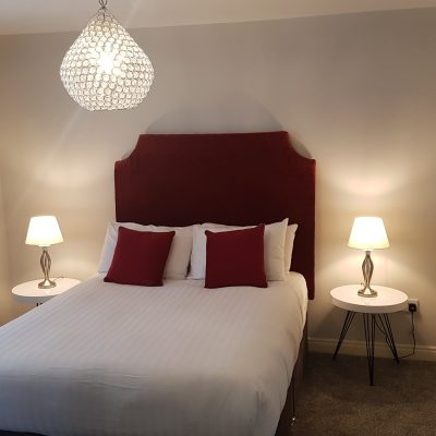 Large bright double room with bedside table lamps in Swallows Retreat in Carlingford