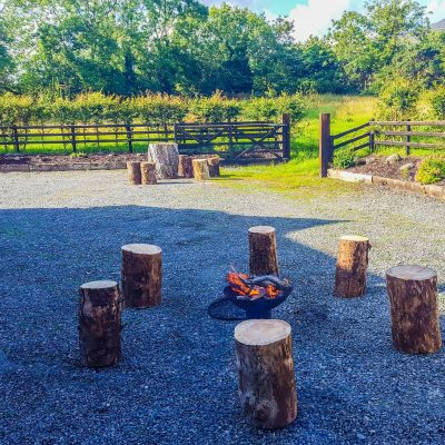 Fire Pit & wooden seats in an area for picnics in Carlingford