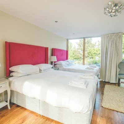 Large bedroom with 2 Double beds with courtyard view