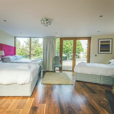Large bedroom with 3 beds and a courtyard view